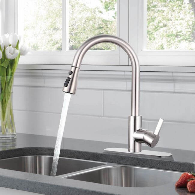 See Dalmo's single handle kitchen faucet, which has support for one or three holes.