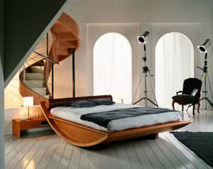 A bed made of Plywood and solid wood by Mazzali