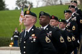 Green Berets stand silent watch during the wreath-laying ceremony at the grave of President John F. Kennedy.