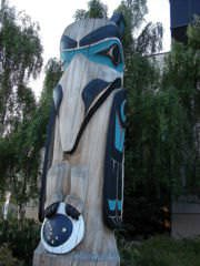A totem pole in Anchorage, Alaska, showing a raven stealing the moon and stars