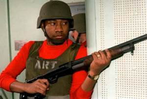 A member of Armed Response Team (ART) raises his Mossberg 500 12-gauge shotgun during a security drill