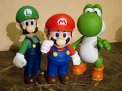 L to R: Luigi, Mario and Yoshi action figures