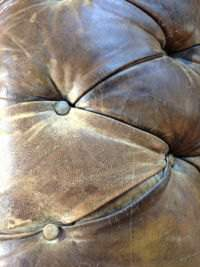 An old leather sofa showing cracks with wear and tear